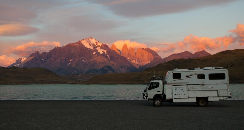 Truck Camper Sunset and Mountains
