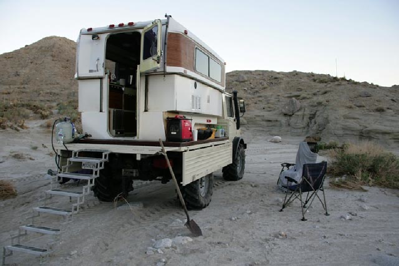 fiberglass camper on flat bed truck