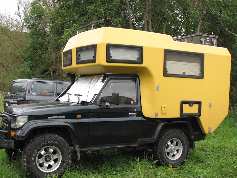 Yellow Camper Black Truck